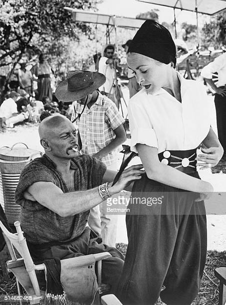 Janet Leigh tries on a gaucho outfit with Yul Brynner's assistance in Salta Argentina Brynner along with Leigh's husband Tony Curtis was in Argentina...
