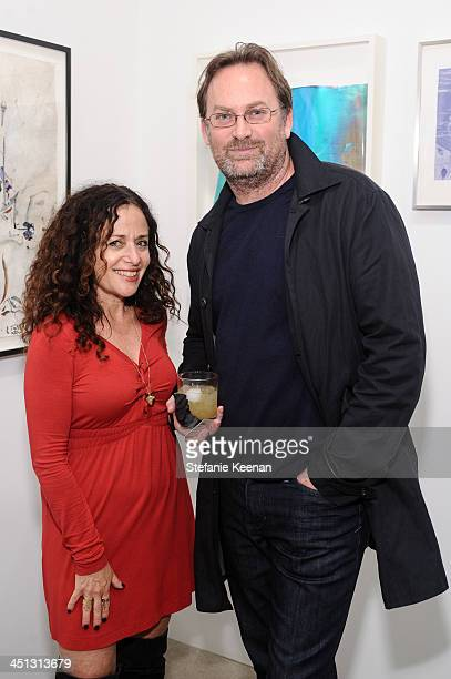 Janet Levy and Chris Tomas attend The Rema Hort Mann Foundation LA Artist Initiative Benefit Auction on November 21, 2013 in Los Angeles, California.