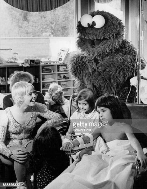 Janet Lynn And Cookie Monster Entertained At Children's Hospital Center is Christine Gonzales of Arvada with Manuel Martinez of Brighton Credit...