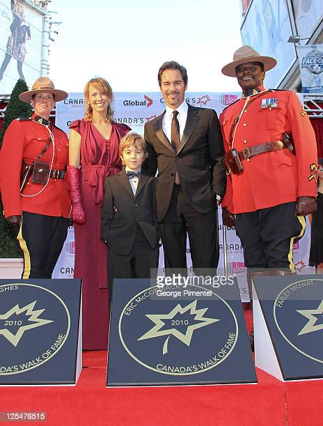 Janet McCormack inductee actor Eric McCormack and son Finnigan McCormack with Canadian Mounties attend Canada's Walk of Fame at the Canon Theatre on...