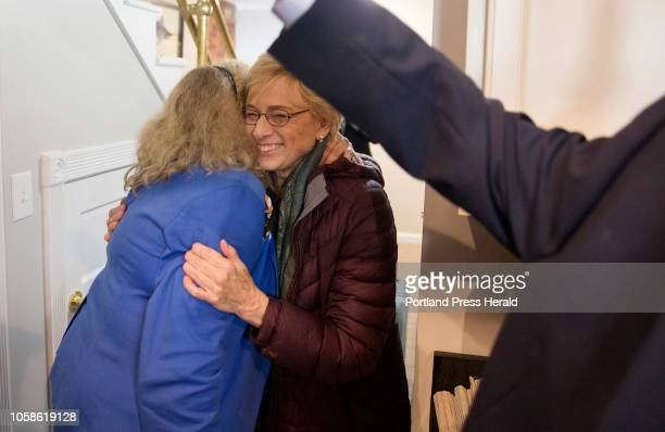 Janet Mills hugs her friends and family moments after receiving the phone call that she officially won the governors race in Portland on Tuesday...