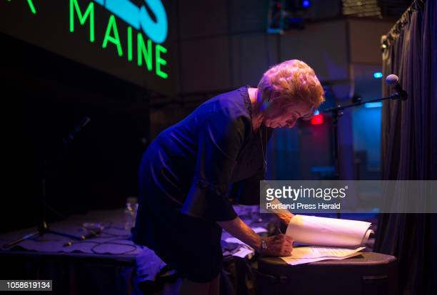 Janet Mills looks over her victory speech moments before she takes the stage in front of hundreds of supporters at the Maine Democrats election night...