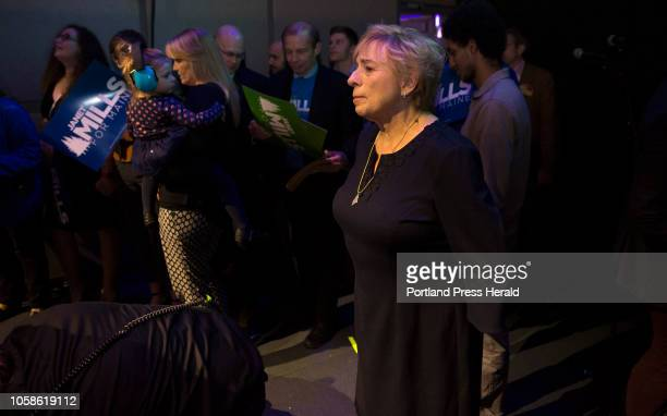 Janet Mills takes a moment to herself as she prepares to head on stage for her victory speech at the Maine Democrats election night party for Mills...