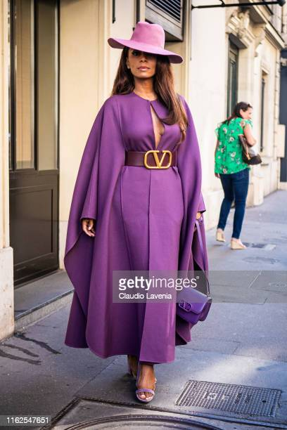 Janet Mock wearing a purple maxi dress with Valentino belt and purple hat is seen outside VALENTINO show during Paris Fashion Week Haute Couture...