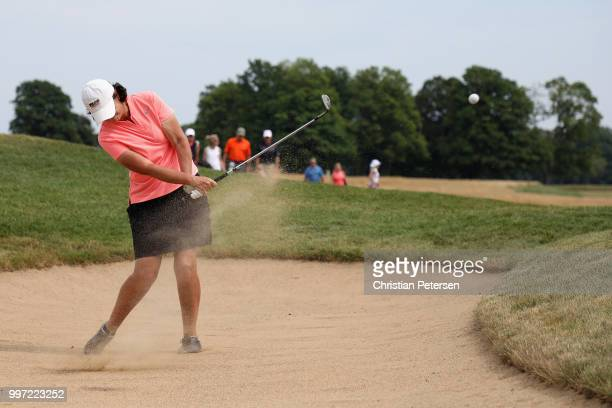 Janet Moore chips from the bunker onto the 18th green during the first round of the US Senior Women's Open at Chicago Golf Club on July 12 2018 in...