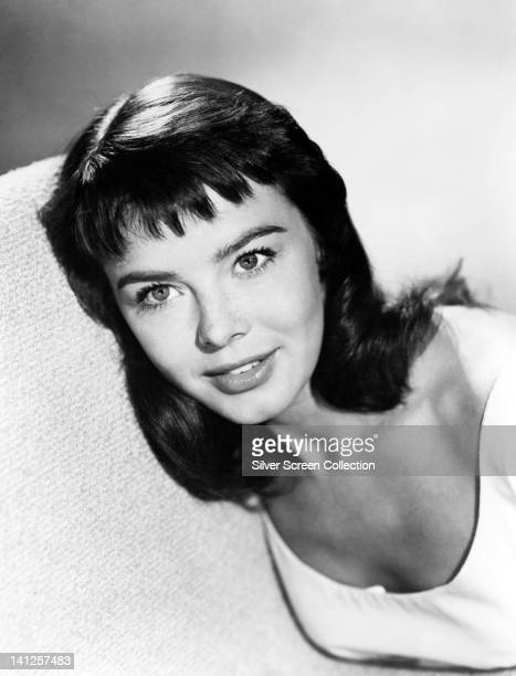 Janet Munro British actress wearing a white top with a scoop neckline in a studio portrait circa 1965
