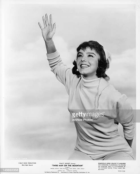 Janet Munro raises her hand in publicity portrait for the film 'Third Man On The Mountain' 1959