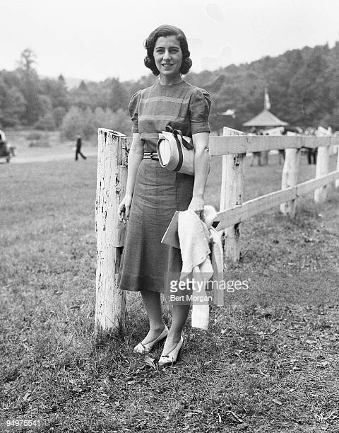 Janet Norton Lee Bouvier mother of Jacqueline Kennedy Onassis standing by a fence in Tuxedo Park New York June 4 1938