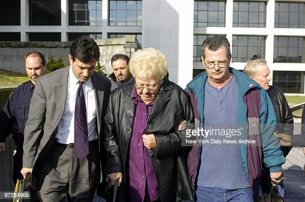 Janet Pelosi Danny Pelosi's mother is escorted from court by Edward Burke a family lawyer and son Robert Pelosi after the jury found her other son...