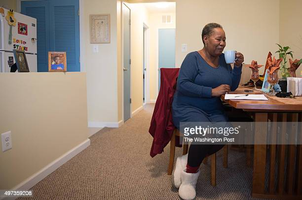 Janet Sharpe works on a list of 'to do' items in her new home in Washington DC on Nov 2 2015 With the help of Open Arms Housing Incwomen like Sharpe...