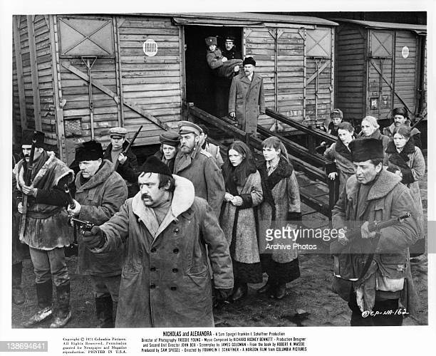 Janet Suzman Michael Jayston and family standing behind gunmen in a scene from the film 'Nicholas And Alexandra' 1971