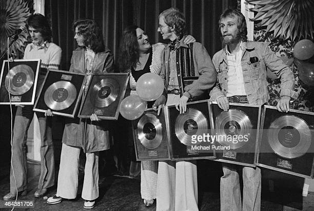 Janet Webb presents British rock group Wishbone Ash with gold discs for their album 'Argus' and silver discs for the 'Wishbone Four' album at a...