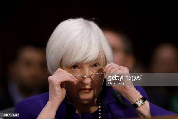 Janet Yellen chair of the US Federal Reserve adjusts her glasses during a Senate Banking Housing and Urban Affairs Committee hearing in Washington DC...