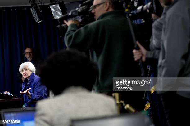 Janet Yellen chair of the US Federal Reserve bottom left speaks during a news conference following a Federal Open Market Committee meeting in...