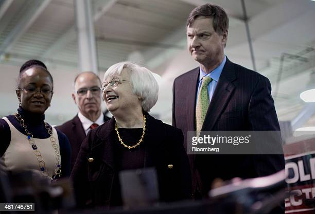 Janet Yellen chair of the US Federal Reserve laughs as she tours the manufacturing lab at Daley College with Charles Plosser chairman of the Federal...