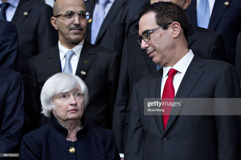 Janet Yellen, chair of the U.S. Federal Reserve, left, and Steven Mnuchin, U.S. Treasury secretary, stand during a Group of 20 (G-20) finance ministers and central bank governors group photo on the sidelines of the International Monetary Fund (IMF) and World Bank Group Annual Meetings in Washington, D.C., U.S., on Thursday, Oct. 12, 2017. Near-term risks to world financial stability have declined since April amid improving macroeconomic conditions and the subsiding risk of emerging-market turmoil, the IMF said in its latest Global Financial Stability Report released yesterday. Photographer: Andrew Harrer/Bloomberg via Getty Images