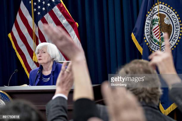 Janet Yellen chair of the US Federal Reserve left waits for a question during a news conference following a Federal Open Market Committee meeting in...