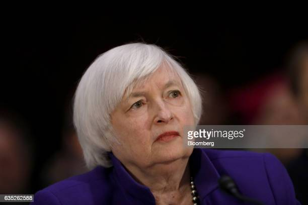 Janet Yellen chair of the US Federal Reserve listens during a Senate Banking Housing and Urban Affairs Committee hearing in Washington DC US on...