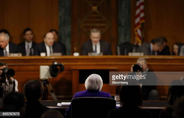 Janet Yellen chair of the US Federal Reserve sits during a Senate Banking Housing and Urban Affairs Committee hearing in Washington DC US on...