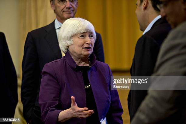 Janet Yellen chair of the US Federal Reserve speaks to an attendee before delivering an address on economic outlook and monetary policy at a World...