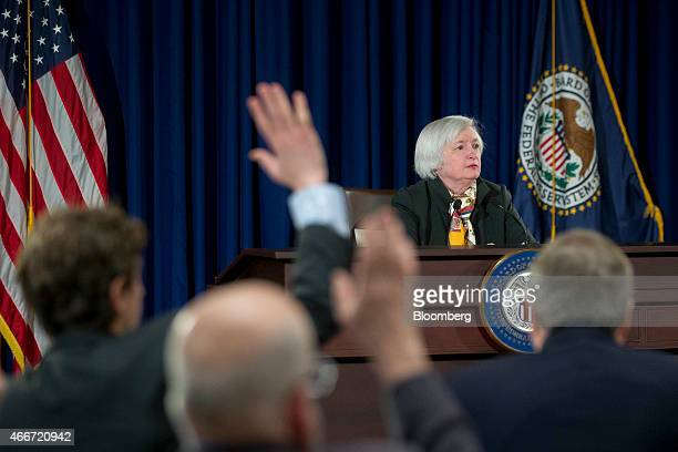 Janet Yellen chair of the US Federal Reserve waits for a question during a news conference following a Federal Open Market Committee meeting in...