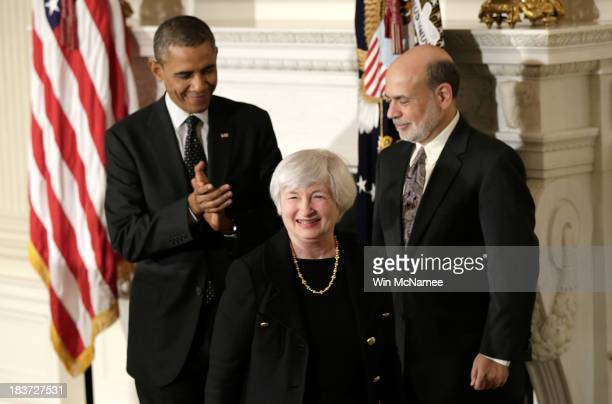Janet Yellen smiles as US President Barack Obama and current Chairman of the Federal Reserve Ben Bernake applaude her during a press conference to...