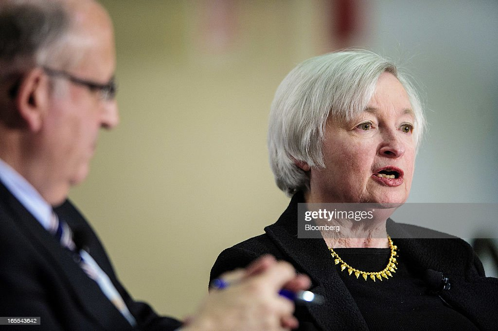 Janet Yellen, vice chairman of the U.S. Federal Reserve, right, speaks while Allan Sloan, senior editor of Fortune Magazine, listens at the Society of American Business Editors and Writers (SABEW) 2013 Spring Conference in Washington, D.C., U.S., on Thursday, April 4, 2013. Yellen said the Federal Open Market Committee should be prepared to alter its $85 billion monthly pace of bond buying based on changes in the economic outlook.Photographer: Pete Marovich/Bloomberg via Getty Images