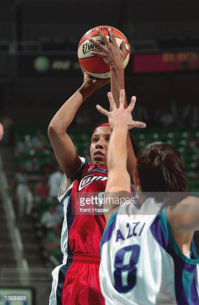 Janeth Arcain of the Houston Comets shoots over Jennifer Azzi of the Utah Starzz in Game one of the Western Conference Semifinals during the 2002...
