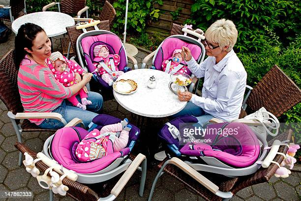 Janett Mehnert and her mother take car of their quadruplets Sophie Jasmin Laura and Kim while having an ice cream during their first holiday at a...