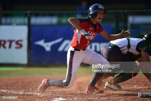 Janette Miiko Reed makes a slide to score on a RBI double by elaney Lyn Spaulding of United States in the fifth inning against Australia during their...