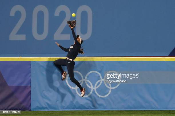 Janette Reed of Team United States makes a catch at the wall in the seventh inning against Team Japan during the Softball Gold Medal Game between...