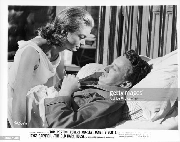 Janette Scott leaning over Tom Poston in bed in a scene from the film 'The Old Dark House' 1963