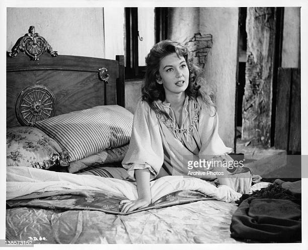 Janette Scott sitting up in bed in a scene from the film 'The Devil's Disciple' 1959