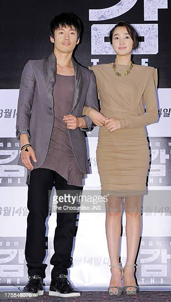 Jang Hyuk and Suae attend the 'The Flu' press conference at Wangsimni CGV on August 7 2013 in Seoul South Korea