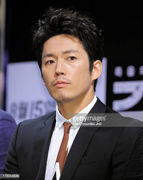 Jang Hyuk attends the 'The Flu' press conference at Apgujeong CGV on July 10 2013 in Seoul South Korea