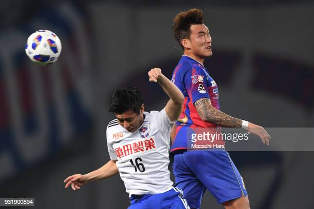 Jang Hyun Soo of FC Tokyo and Arata Watanabe of Albirex Niigata compete for the ball during the JLeague YBC Levain Cup Group A match between FC Tokyo...