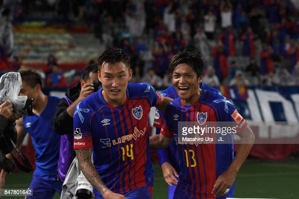 Jang Hyun Soo of FC Tokyo celebrates scoring the opening goal with his team mate Yoshito Okubo during the JLeague J1 match between FC Tokyo and...