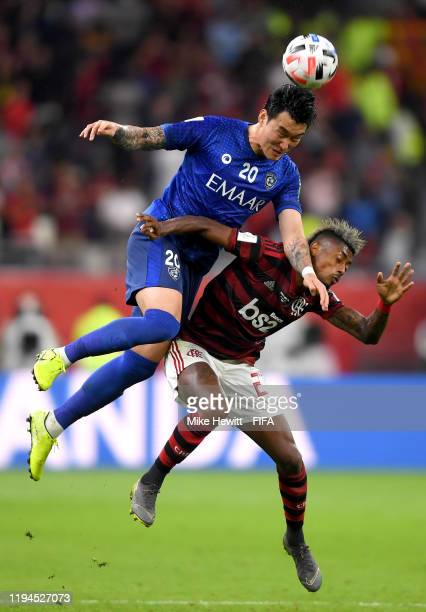 Jang Hyunsoo of Al Hilal SFC and Bruno Henrique of CR Flamengo battle for the ball during the FIFA Club World Cup semifinal match between CR Flamengo...