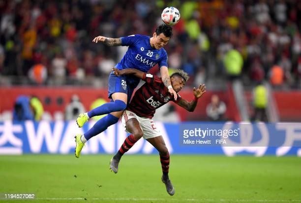Jang Hyunsoo of Al Hilal SFC and Bruno Henrique of CR Flamengo battle for the ball during the FIFA Club World Cup semi-final match between CR...