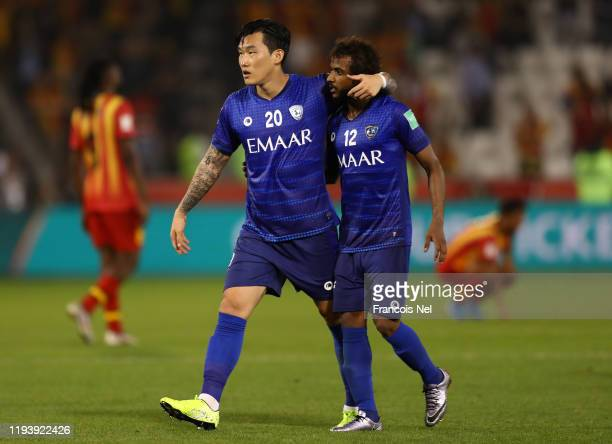 Jang Hyunsoo of Al Hilal SFC embraces Yasser AlShahrani of Al Hilal SFC during the FIFA Club World Cup 2nd round match between Al Hilal and Esperance...