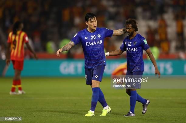 Jang Hyunsoo of Al Hilal SFC embraces Yasser AlShahrani of Al Hilal SFC during the FIFA Club World Cup 2nd round match between Al Hilal and Esperance...