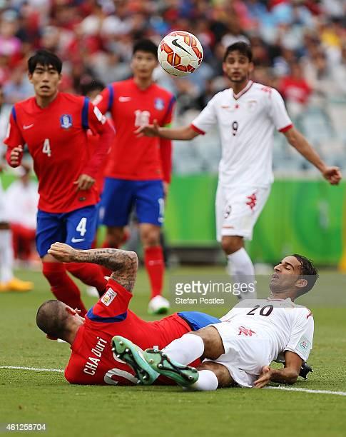 Jang Hyunsoo of Korea Republic and Imad Al Hosni of Oman contests possession during the 2015 Asian Cup match between Korea Republic and Oman at...