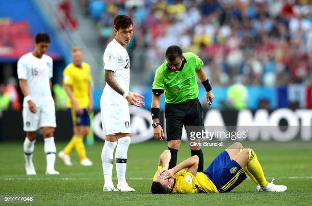 Jang HyunSoo of Korea Republic reacts as Marcus Berg of Sweden goes down whilst Referee Joel Aguilar checks if he is ok during the 2018 FIFA World...