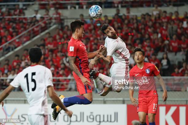 Jang Hyunsoo of South Korea and Morteza Pouraliganji of Iran compete for the ball during the FIFA World Cup Russia Asian qualifier match between...