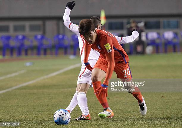 Jang HyunSoo of South Korea competes for the ball with Hassan Maatouk of Lebanon during the 2018 FIFA World Cup Qualifier Round 2 Group G match...