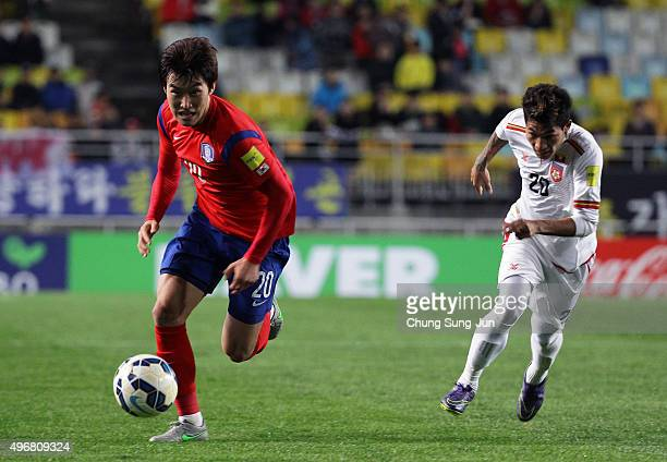Jang HyunSoo of South Korea competes for the ball with Suan Lam Mang of Myanmar during the 2018 FIFA World Cup Qualifier Round 2 Group G match...