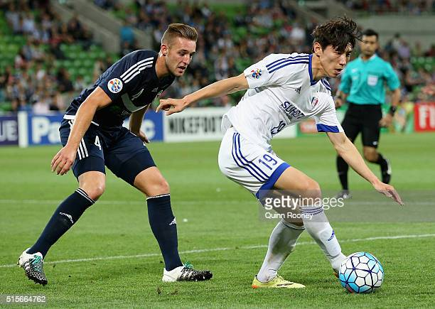 Jang Hyunsoo of Suwon controls the ball infront of Nick Ansell of the Victory during the AFC Champions League match between the Melbourne Victory and...