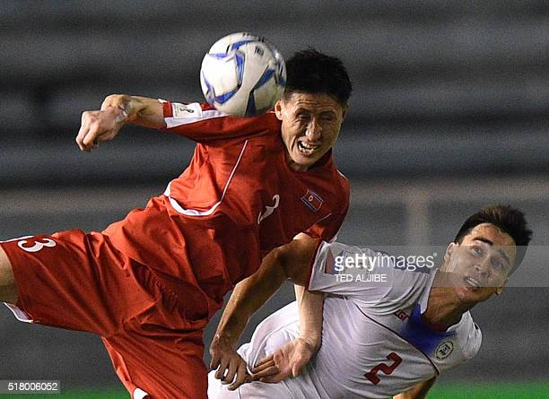 Jang Kuk Chol of North Korea vies for the ball with James Younghusband of the Philippines during their 2018 World Cup qualifying football match in...