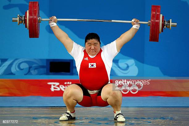 Jang Miran of South Korea attempts a lift in the women's +75kg group A weightlifting event at the Beijing University of Aeronautics & Astronautics...