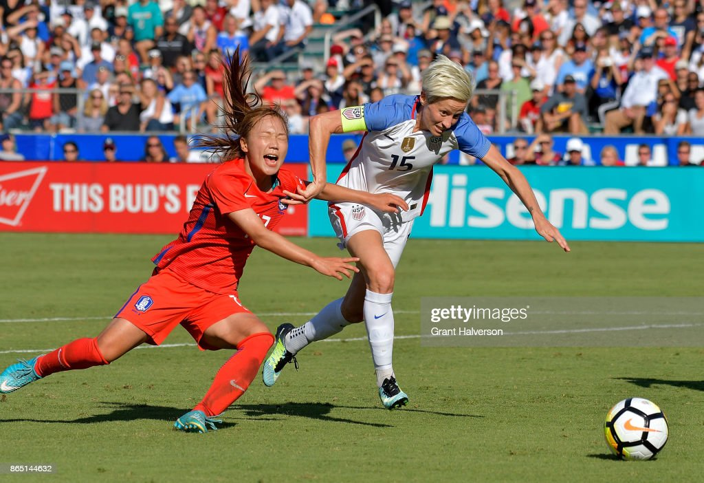 Jang Selgi #17 of Korea Republic defends a run by Megan Rapinoe #15 of USA during their game at WakeMed Soccer Park on October 22, 2017 in Cary, North Carolina. The USA won 6-0.